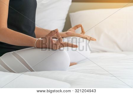 Middle Aged Women Doing Yoga Easy Pose To Meditation With Yoga In Bedroom At The Morning, Adho Mukha