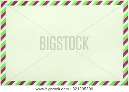 Old Post Striped Envelope, Background With Copy Space. Light Green Mail Letter With Stripped Vintage