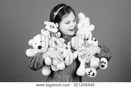 Happy childhood. Little girl play with soft toy teddy bear. Lot of toys in her hands. Childhood concept. Collecting toys hobby. Cherishing memories of childhood. Small girl smiling face with toys poster