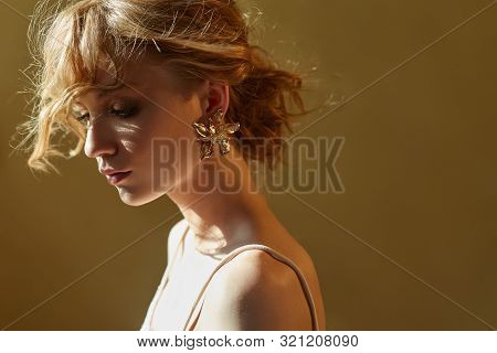 Earrings And Jewelry In Ear Of A Sexy Blonde Woman Pressed. Perfect Blonde Girl, Gorgeous Mysterious