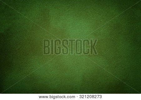 Dark Green Matte Background Of Suede Fabric, Closeup. Velvet Texture Of Seamless Emerald Leather. Fe