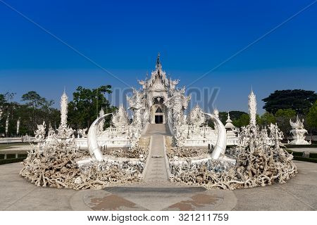 Wat Rong Khun In Chiangrai, Thailand During Summer With Blue Sky Day Time.