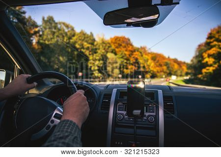 Man Hands On Steering Wheel Riding By Autumn Speedway Fall Season Car Travel