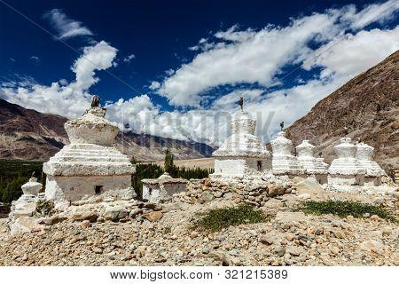 Whitewashed chortens (Tibetan Buddhist stupas). Nubra valley, Ladakh, India