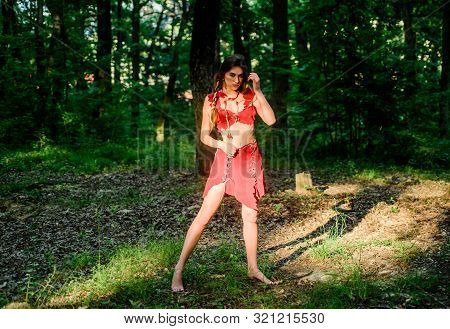 Wild Woman In Forest. Sexy Girl Early Stage In The Evolutionary Development. Culture Of Wild Human.