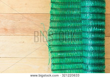Shading Green Net Filter On Wood Plate