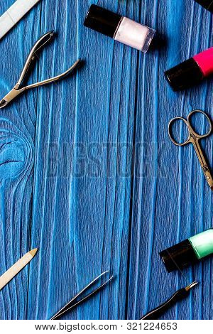 Nail Polish And Manicure Set On Dark Wooden Background
