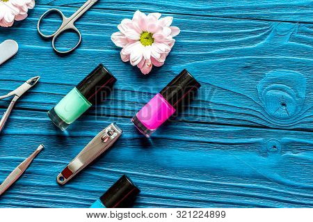Nail Polish And Spa Manicure Set On Dark Wooden Background