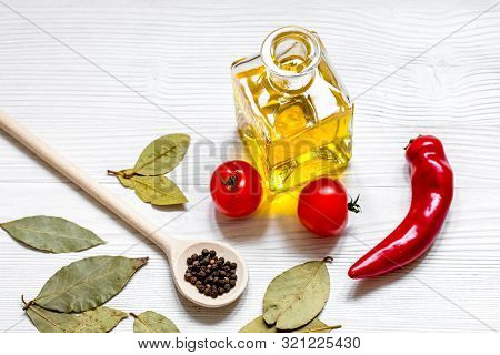 Oil With Spices And Chilli On Wooden Background