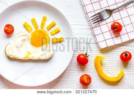 Sunshine Fried Eggs Breakfast For Kid On Wooden Background
