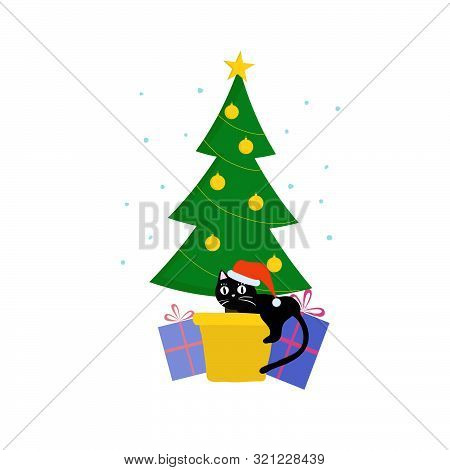 Mischievous Cat In Christmas Hat Tries To Clamber Up Christmas Tree. Moment Of Cat Playing On New Ye