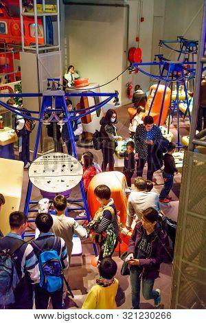 Hong Kong, China - January 20, 2016: Tourists Crowding In Hong Kong Science Museum. People Study Att