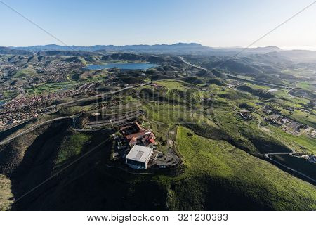 Simi Valley, California, USA - March 26, 2018:  Aerial view of Ronald Reagan Presidential Library and Center for Public Affairs and suburban valleys in Ventura County, California.