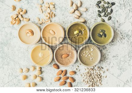 Nuts And Seeds Butter In Jars With Ingredients. Homemade Raw Organic Peanut, Almond, Hazlenut, Cashe