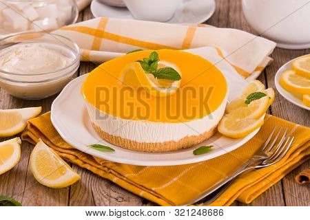 Lemon And Mascarpone Cheesecake On White Dish.