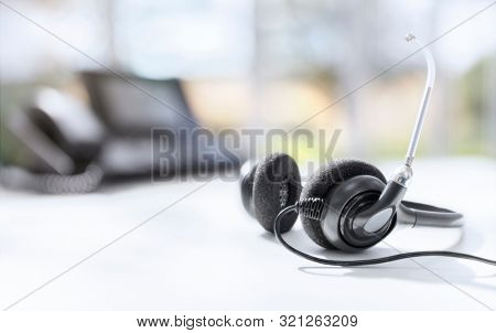 VOIP headset headphones telephone on office desk concept for communication, it support, call center and customer service help desk