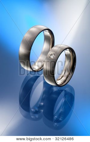 A pair of wedding rings with briliant cut diamonds