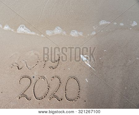 New Years 2020 Replace 2019 Concept. End Of 2019 Happy New Year 2020, Lettering On Beach With Wave A