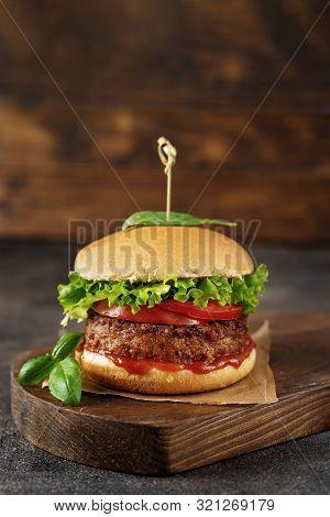 Vegan Burger On Dark Rustic Brown Background