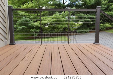 New Deck With Metal Wire Railing - Composite Wood