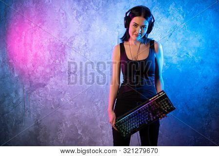 Funny Nerd Girl Wearing Glasses Carrying Computer Keyboard