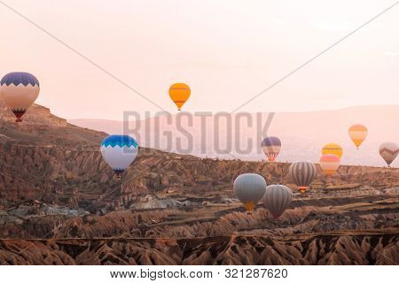 Colorful Hot Air Balloons Flying Over The Valley At Cappadocia Sunrise Time Popular Travel Destinati