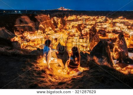 Asian Couple In Love And Looking Night View Of Uchisar Goreme Sunset View Point ,cappadocia. Nevsehi