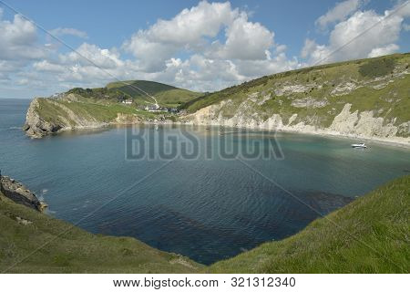 View Over Lulworth Cove Rock Formations And Strata On The Dorset Coast