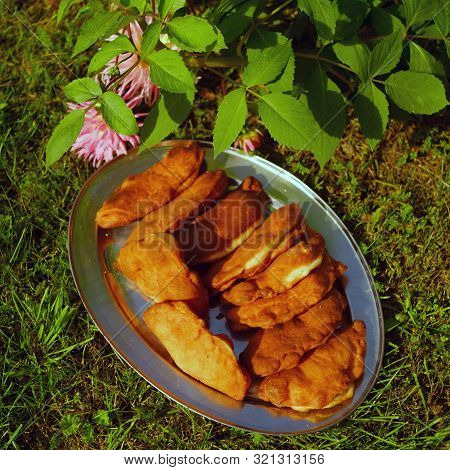 Hotcakes Ready To Eat On A Silver Tray, Outdoor Shot, Concept Of A Garden Party Ot Picnic, Focus In