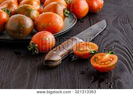 Fresh Red Ripe Tomatoes On Rustic Board