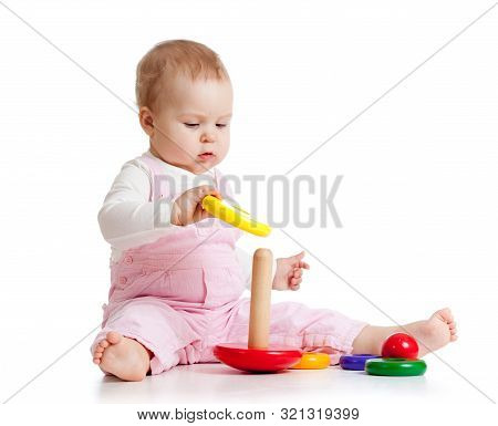 Nursery Baby Playing With Toy. Isolated On White Background