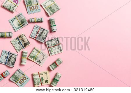 Dollar Bills. Pile Of One Hundred Us Dollar Bills Money On Colored Background Top Wiev With Copy Spa