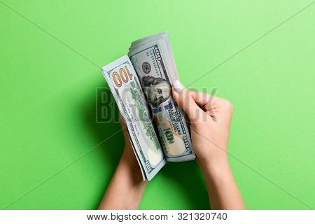 Businesswomans Hands Counting One Hundred Dollar Bills On Colorful Background. Salary And Wage Conce