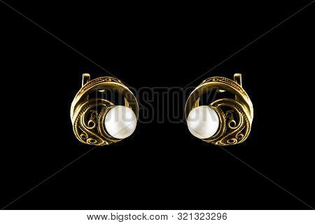 Vintage Elegance Gold Earrings With White Pearl On Black Background