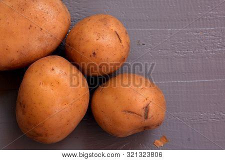 Fresh Raw Potatoes On Dark Wooden Background/ Flatware/ Food Photography/ Young Raw Unpeeled Potatoe