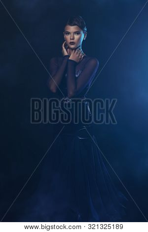 Charming young woman in a luxurious evening dress. Portrait of a beautiful professional dancer. Beauty, fashion.