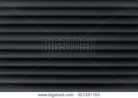 Abstract Pattern Of Lines. Texture Of Black Corrugated Metallic Surface. Dark Ribbed Background With