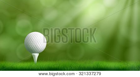 Golf Ball Resting On Tee Pushed Into Ground, Cowered Thick Lawn Grass, Blurred With Bokeh Sunbeams O