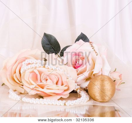 Vintage beads with roses and candle on white background