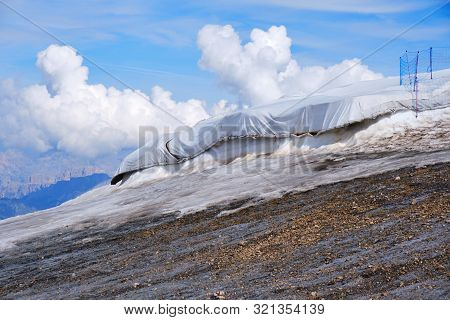Marmolada Glacier, Italy - August 28, 2019: Compacted Snow Protected With White Sheets Against Melti