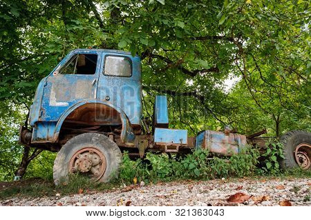 Old Rusty Abandoned Broken Truck In The Forest