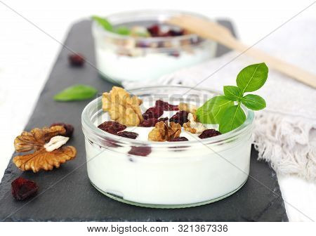 Fresh Yogurt Pot With Nuts And Dried Blueberries