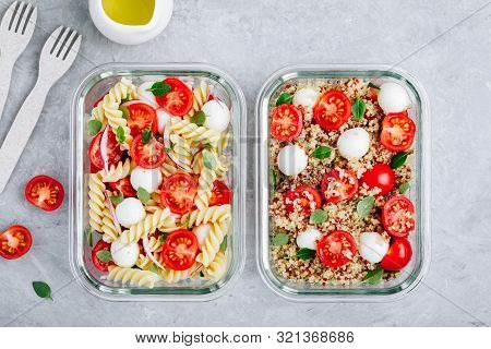 Meal Prep Containers With Pasta Salad Or Quinoa, Tomatoes, Mozzarella Cheese, And Basil.