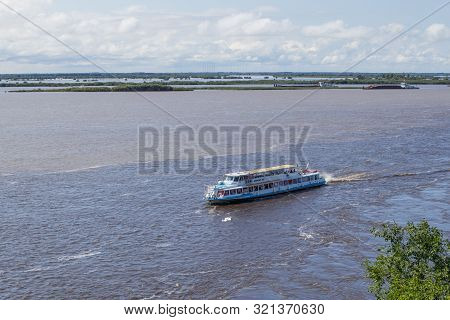 Khabarovsk, Russia - August 20, 2019. Walking Excursion River Ship With Tourists Moves Along Amur Ri