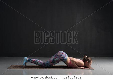 Woman Doing Knees-chest-chin, Eight Limbed Pose Or Ashtanga Namaskarasana