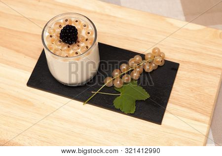White Currant And Yoghurt Dessert A Dessert Of Yoghurt And White Currants With A Black Berry Topping