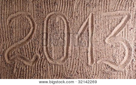 Inscription 2013 On Sand
