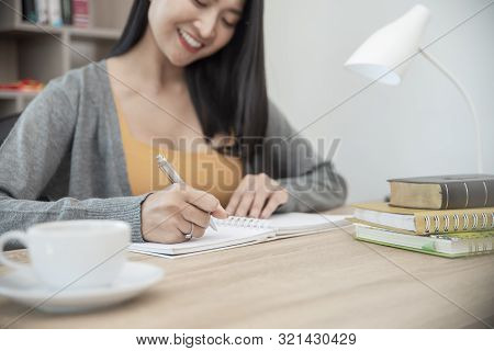 On Diary And Calendar Page,female Hand Planner Or Organizer Writing Daily Appointment.asian Woman Ma
