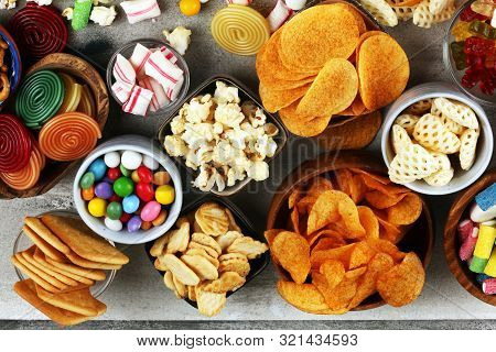 Salty Snacks. Pretzels, Chips, Crackers And Candy Sweets On Table