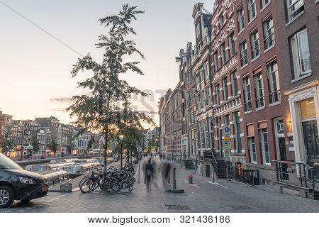 Amsterdam, Netherlands - June 6, 2019: Oude Turfmarkt Street At Sunset Time.